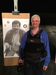 Me and my perp. (Not bad for my first shooting experience, until you consider this was from 3 yards.)